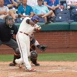 Phillies first baseman Ryan Howard hits a two -run homer in the sixth inning Thursday at Citizens Bank Park.
