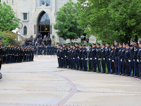 An honor guard of police officers stands in front of St. John's Catholic Church on the campus of Creighton University during the funeral service of Omaha Police Officer Kerrie Orozco in Omaha on Tuesday.
