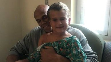 Former MSU football player Josh Thornhill and Marcus, his 5-year-old son.