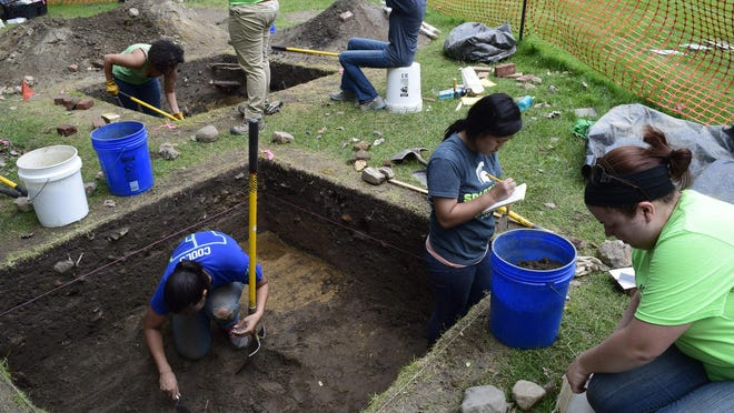 MSU's archaeology field school participants dig at a spot between the administration building and the river, where they found a variety of glass, ceramic and household objects.