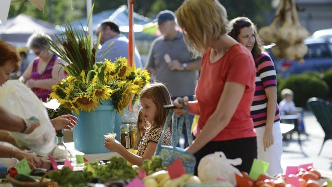 Visitors enjoy the Madeira Farmer's Market, which is working on transitioning to a new manager and from a for profit business to a nonprofit.