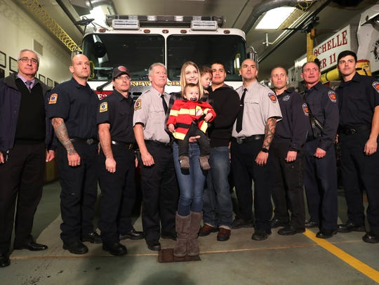 New Rochelle fire fighters and officers pose for photo