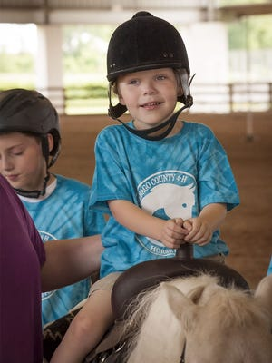 A young boy enjoys a ride during the Winnebago County 4-H Horse and Pony Autism Ride in July 2015. This Sunday will mark the fifth year the 4-H Horse and Pony Project members will host the event.