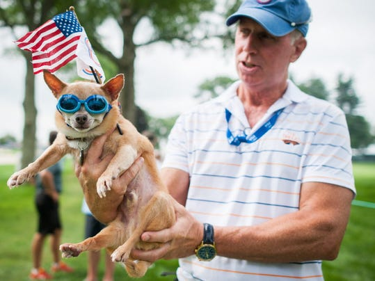 Peter Flach holds therapy dog Cheech outside of the 10th fairway during the first round of the U.S. Women's Open Championship at Lancaster Country Club on July 9.
