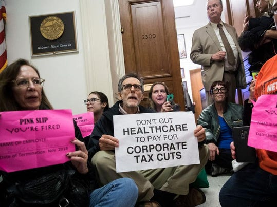 Tax Bill Protestors Hold Sit Ins At GOP Republican Offices On Capitol Hill