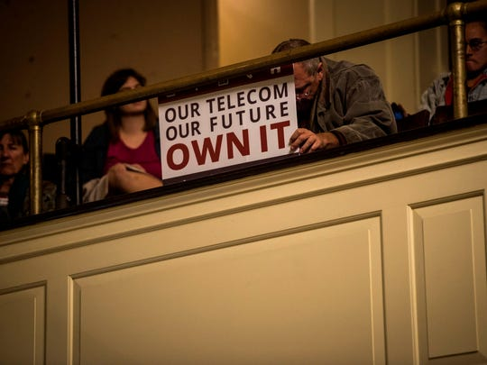 Supporters of Keep Burlington Telecom Local listen to public comments during the Burlington City Council meeting Monday night, Oct. 30, 2017.