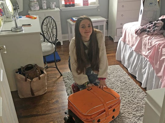 Foreign exchange student Sara Lopez Gomez packs her suitcase for her return trip home to Spain after spending her sophomore year of high school in Fairview.
