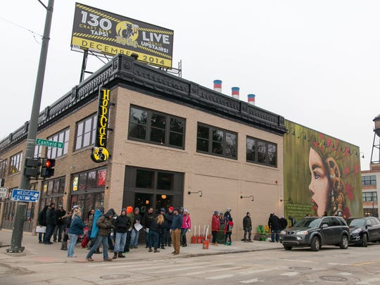 A long line of over 1000 eager beer lovers waited for up to five hours for the opening of HopCat Restaurant and Craft Beer Bar on Woodward Ave. and West Canfield in Midtown Detroit on Saturday, December 13, 2014. John Froelich/Special to Free Press