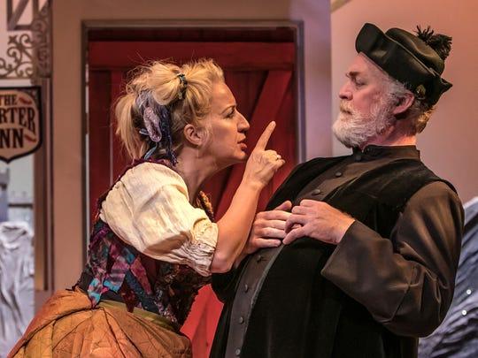 Mistress Quickly (Kristie Dale Sanders) chastises Sir Hugh Evans (Ames Adamson).