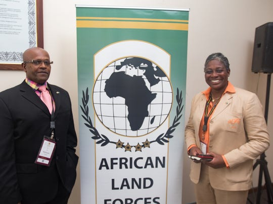 (From left) Larry Robinson, chief of Anti-Terrorism / Force Protection directorate, U.S. Army Africa, stands with Tulip Frazier, chief of Operational Protection directorate, in front of the official African Land Forces Summit banner during the event, May 16, 2016 in Arusha, Tanzania. ALFS is an annual, weeklong summit bringing together land force chiefs of staff from throughout the African continent to discuss mutual threats and challenges from a regional perspective.