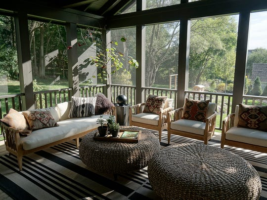 A large screened porch is added to the rear of the
