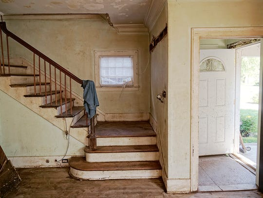 The entrance to the home, with stairs leading to the