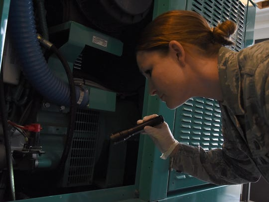 Staff Sgt. Tara Kindermann, 490th Missile Squadron facility manager, inspects the diesel electric unit generator at a missile alert facility Oct. 19, 2016, at Malmstrom Air Force Base, Mont.The DEU provides power to the site when commercial power is unavailable.
