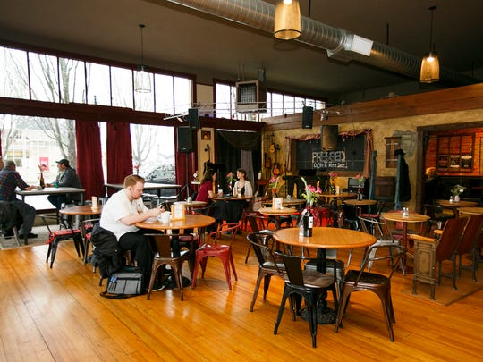Pressed Coffee & Wine Bar in Dallas has a stage for live music on Friday nights and open mic nights on Tuesdays.