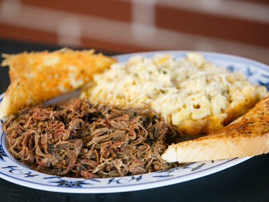 The pulled brisket meal, with Cindy Lou's Mac N Cheese and Texas Garlic Toast, is served at Cindy Lou's BBQ.