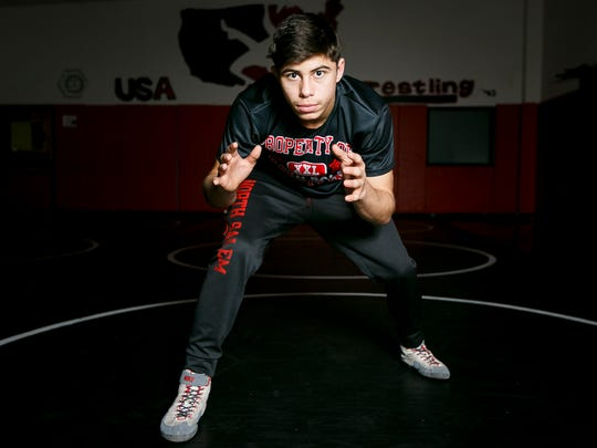 North Salem sophomore Ian Carlos is undefeated this wrestling season. With state championships coming this weekend, Carlos is confident he'll be crowned OSAA Class 6A champion in the 145-pound division.