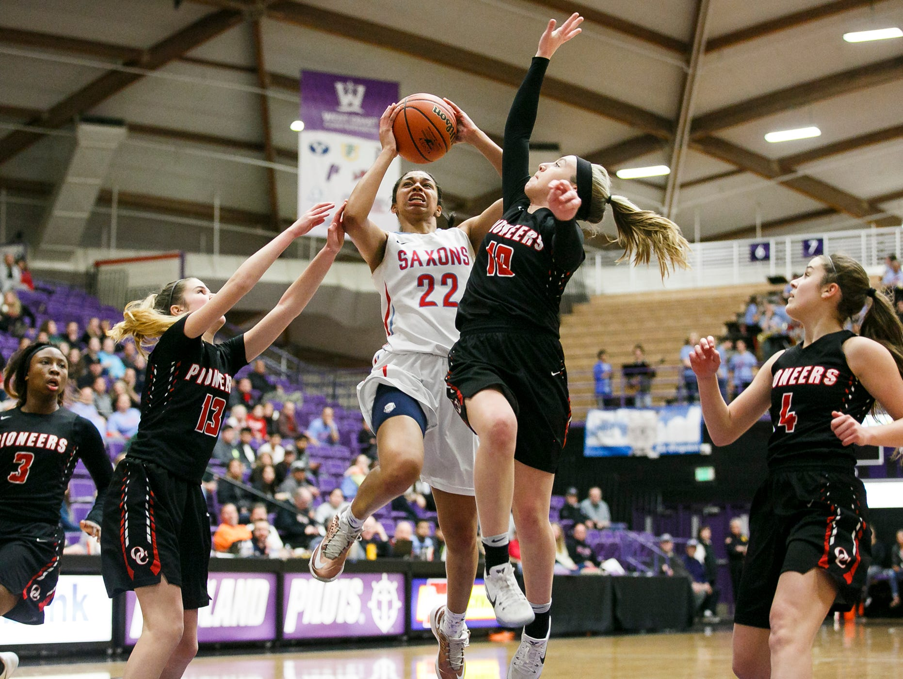 South Salem's Evina Westbrook goes up for a basket over Oregon City defense in the OSAA 6A semifinal state championships on Friday, March 10, 2017, at the University of Portland. South Salem lost 46-54.