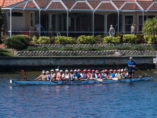 Paddlers cruise past a house on Charlotte Harbor.