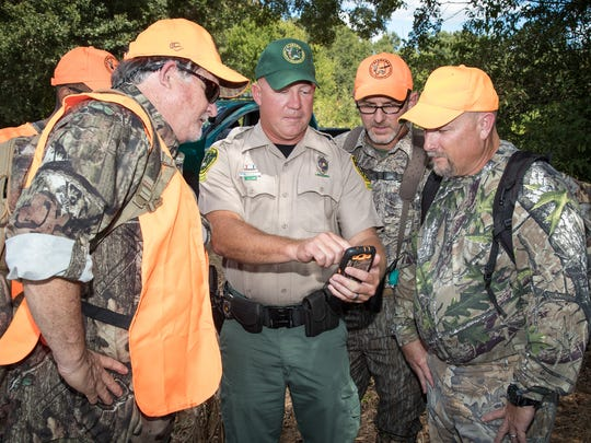 A conservation enforcement officer tells hunters about