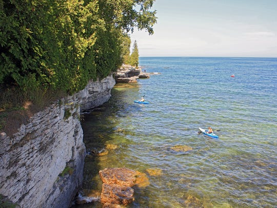 Kayakers explore Cave Point County Park south of Jacksonport