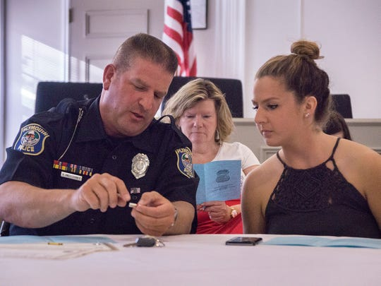 Police Officer of the Year Tony Angelosanto shows daughter