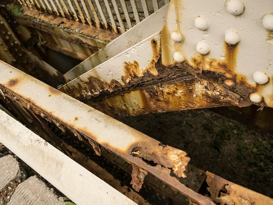 The steel is badly corroded and the bridge is considered unsafe for traffic.