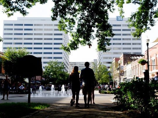 People walk through Market Square in Knoxville, Tennessee