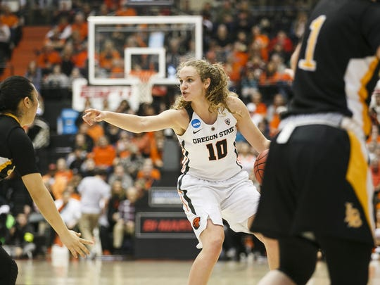 Oregon State's Katie McWilliams looks for an open teammate against Long Beach State in the first round of the 2017 NCAA Division I Women's Basketball Championship at Gill Coliseum in Corvallis, Ore.