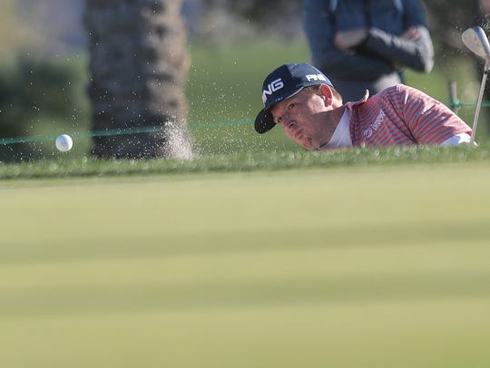 Martin Piller hits his ball out of the sand on 9 at