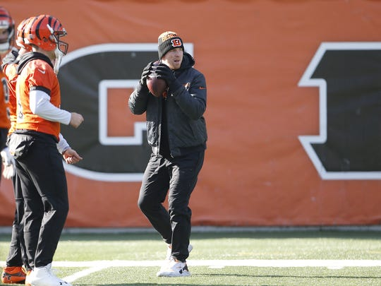 Cincinnati Bengals quarterback Andy Dalton holds the ball in a throwing stance during practice on Wednesday.