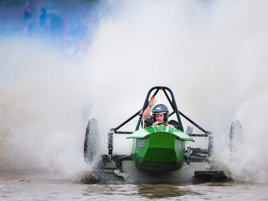 Andy Sims crosses the finish line in the buggy Pressure On during the Swamp Buggy Races Winter Classic on Sunday at the Florida Sports Park.