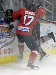 """Thunderbolts """"enforcer"""" Al Graves gives a hard check on Huntsville's Christian Powers into the boards last season. He will lead Evansville against Peoria in its season opener at 7:15 p.m. Friday at Ford Center."""