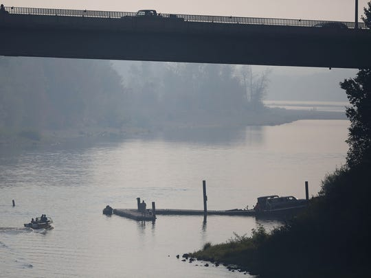 Thick smoke and haze is seen from the Union Street Bridge looking to the southwest, it was not due to a nearby fire, but  from winds that blew smoke southward from a wildfire near Estacada. Photo taken on Sunday, Sept. 14, 2014, in Salem, Ore.