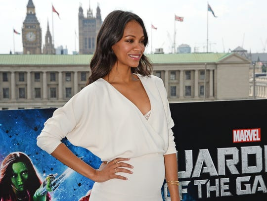 LONDON, ENGLAND - JULY 25:  Zoe Saldana pose at the