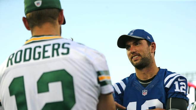 Indianapolis Colts quarterback Andrew Luck, right, talks with Green Bay Packers quarterback Aaron Rodgers prior to the Hall of Fame Game.