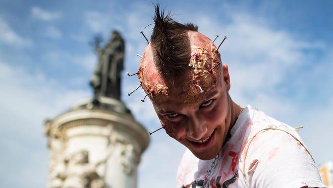 """Participants attend the """"Zombie Walk"""" in Paris."""