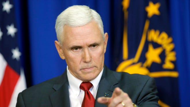 Then-Indiana Gov. Mike Pence takes a question during a March 31, 2015, news conference discussing the state's new Religious Freedom Restoration Act.