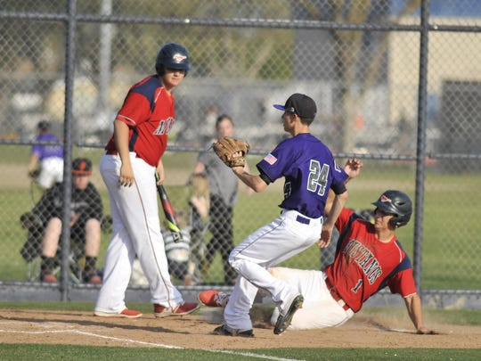 Tulare Western's Payton Silva rounds home on a wild