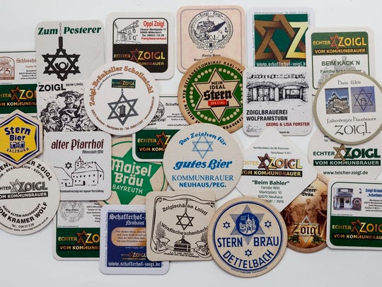 A collection of beer coasters, many with the Zoigl