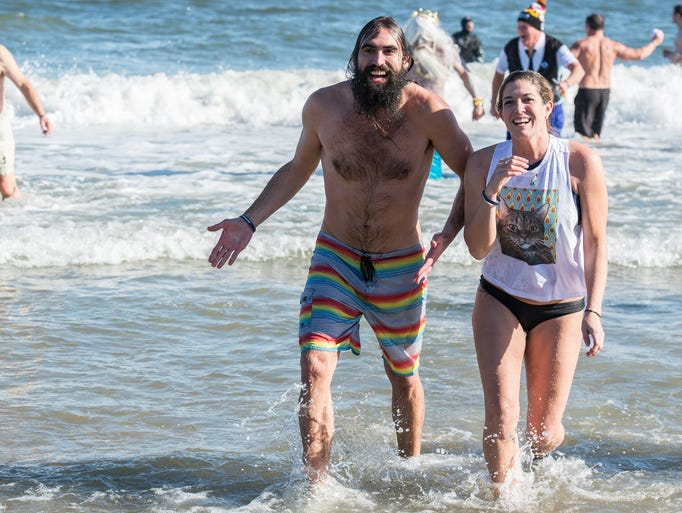 A man and a woman emerge from ocean during the 24th