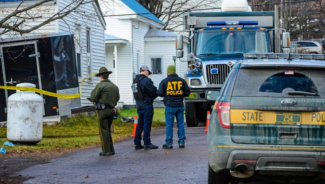 Authorities investigate the scene in Northfield on Thursday, December 10, 2015, where a homemade pipe bomb exploded Wednesday.
