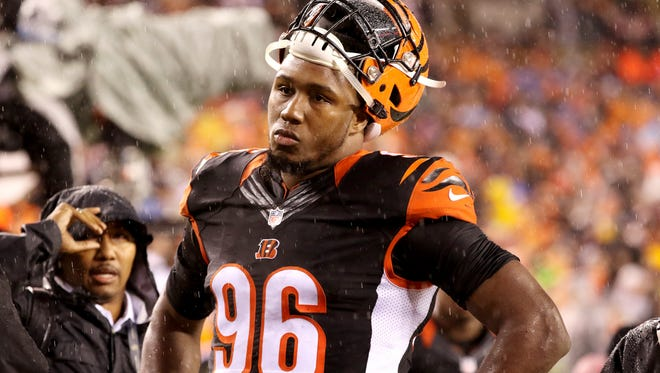 The Bengals' Carlos Dunlap looks dejected as the Bengals lose to the Steelers 18-16 in the final seconds of the playoff game at Paul Brown Stadium Saturday January 9, 2016.