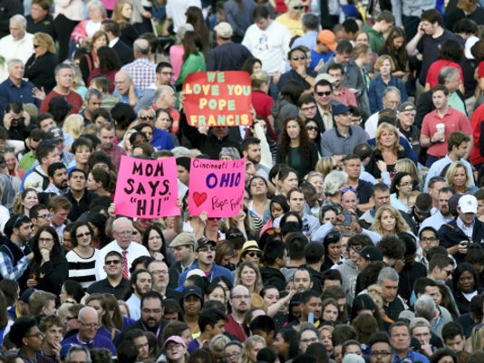 People wait for Pope Francis to appear from the Speaker's Balcony on Capitol Hill in Washington, Thursday, Sept. 24, 2015. The Pope will address a joint meeting of Congress making him the first pontiff in history to do so. (AP Photo/Susan Walsh)