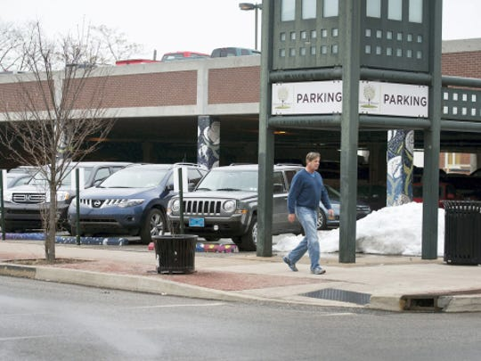 A pedestrian walks past the Central Market parking deck at West Philadelphia and North Beaver streets in York.