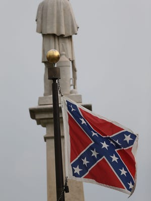 The Confederate flag flies on the state Capitol grounds in Columbia, S.C., on June 22, 2015.