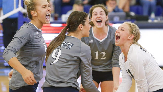 Shawnee Heights product Faith Rottinghaus, right, celebrates with her Washburn volleyball teammates during the 2019 season. The Ichabods are tentatively slated to open the '20 season Oct. 3 at Lee Arena against Central Oklahoma and Newman.