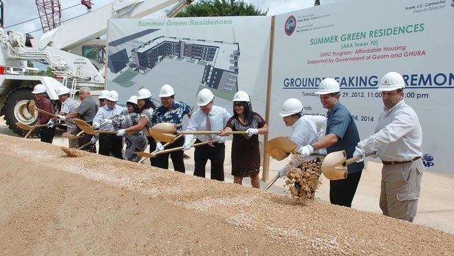In this January 2013 file photo, elected officials, representatives of the Guam Housing and Urban Renewal Authority Board of Commissioners and Core Tech Development executives participate in a groundbreaking ceremony for the Summer Green Residences project in Tamuning. Core Tech has been awarded additional federal tax credits to build more affordable housing.
