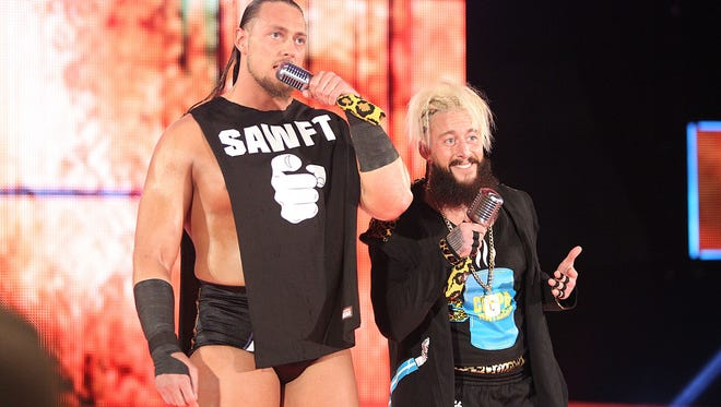 "WWE tag team Colin ""Big Cass"" Cassady, left, and Enzo Amore are known for their electric entrances and many catchphrases."