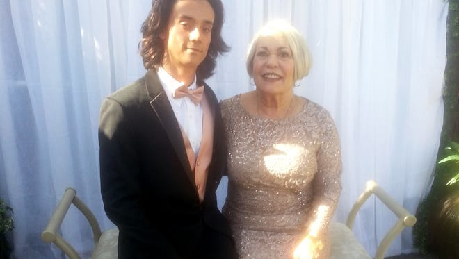 Michael Ganczewski, 17, takes his 71-year-old grandmother, Josephine Ganczewski, to the Adolfo Camarillo High School prom on Saturday.