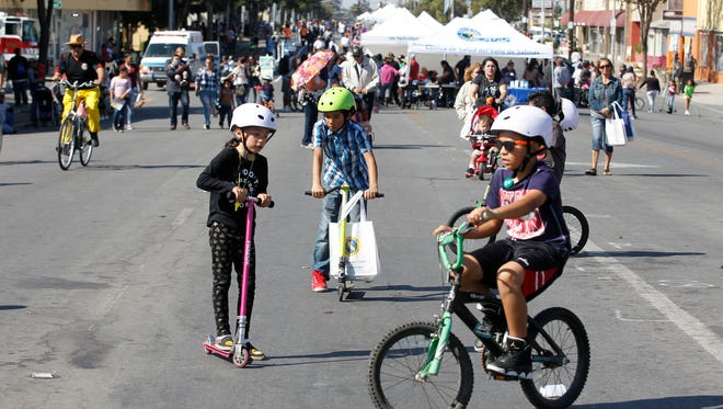 Cyclists and people on foot participate in the fifth annual Ciclovía Salinas held on Alisal Street, between Main Street and Sanborn Street, on Sunday, October 15, 2017 in Salinas, Calif. Vernon McKnight/for The Californian